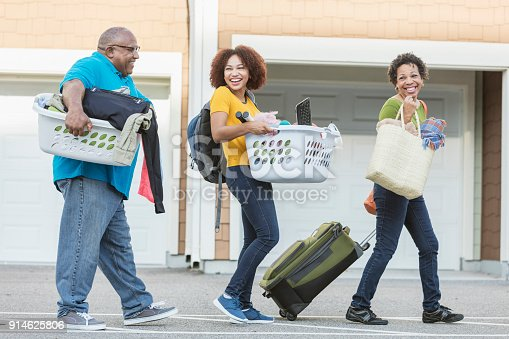 istock African-American parents helping daughter move 914625806