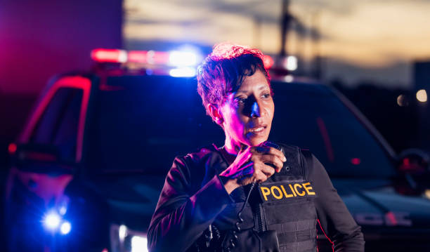 African-American policewoman talking on radio stock photo