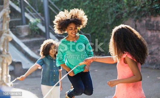 istock African-American sisters jumping rope 1037091670