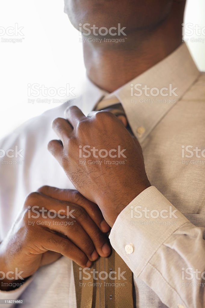 African-American Straightening His Necktie royalty-free stock photo