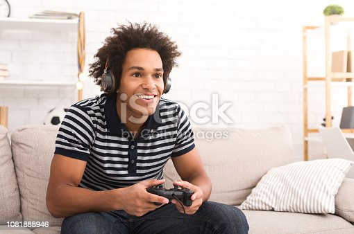 istock African-american teenager playing video games at home 1081888946