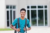 istock African-American teenager standing outside school 1298022621