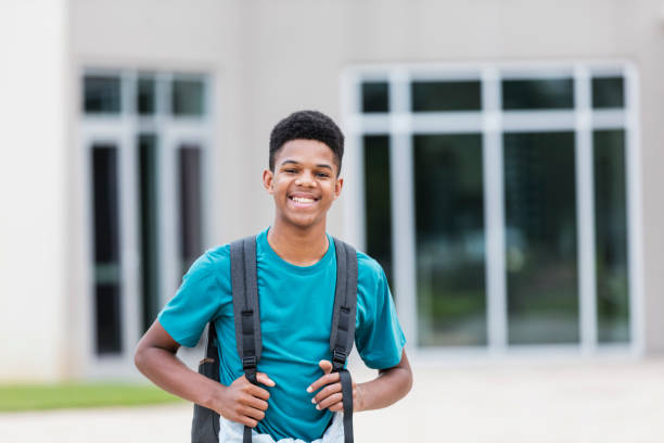 African-American teenager standing outside school stock photo