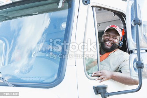 istock African-American truck driver in driver's seat 920496608