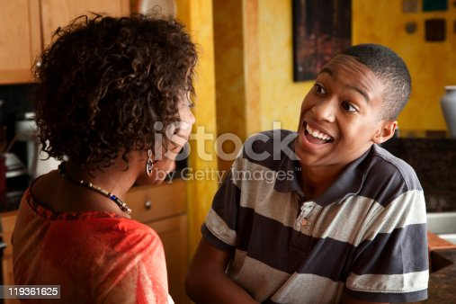 istock African-American woman and teen laugh in kitchen 119361625