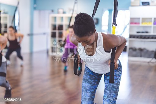 istock African-American woman does a suspension workout at the gym 1089804218