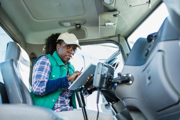 African-American woman driving a semi-truck stock photo