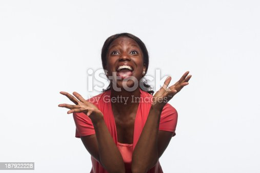 istock African-American woman excited, looking up 187922228