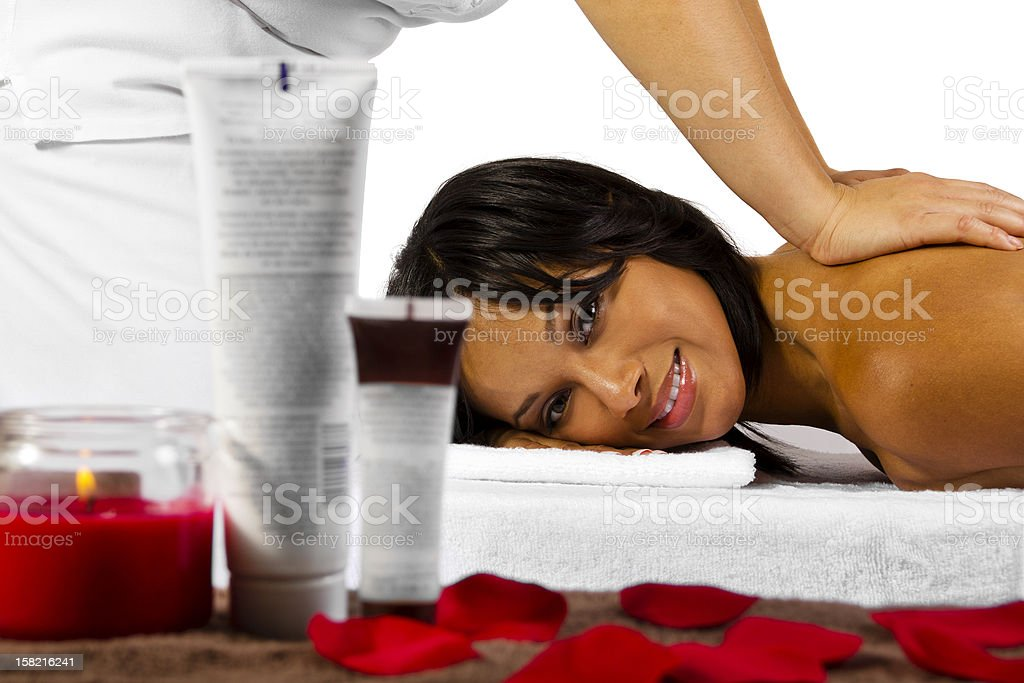 African-American Woman Getting a Massage with a Spa Product royalty-free stock photo
