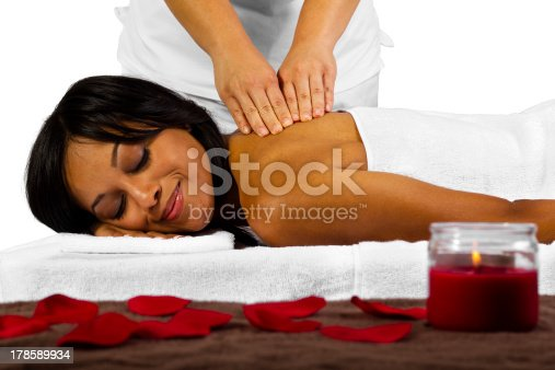 istock African-American Woman Getting a Relaxing Massage at a Spa 178589934