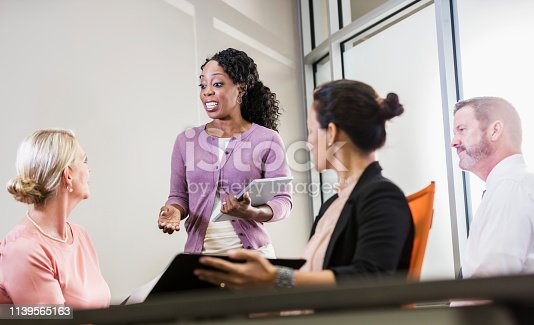 istock African-American woman in business meeting 1139565163