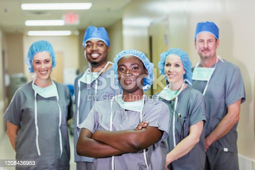 istock African-American woman on team of medical professionals 1208436953