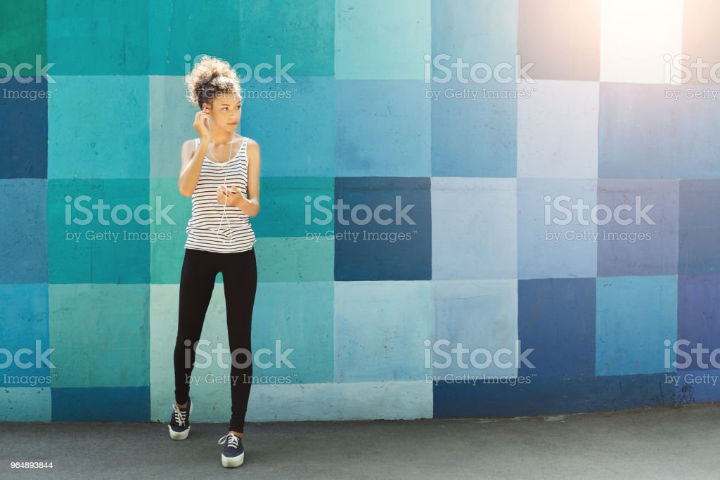 African-american woman posing at bright wall royalty-free stock photo