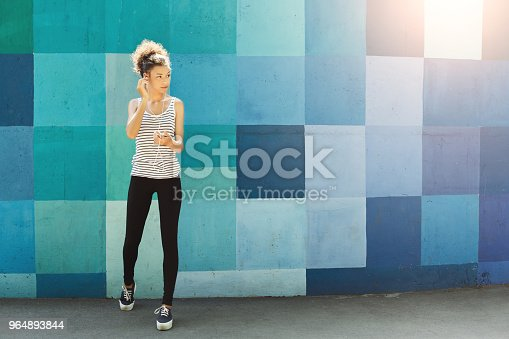 Africanamerican Woman Posing At Bright Wall Stock Photo & More Pictures of Adult