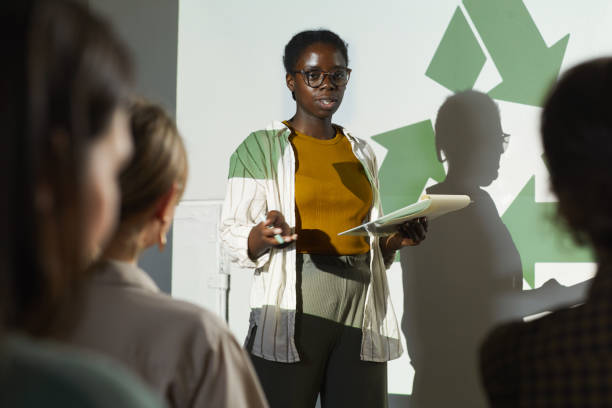 African-American Woman Presenting at Eco Conference stock photo