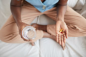 istock African-American Woman Taking Medication Top View 1293446961