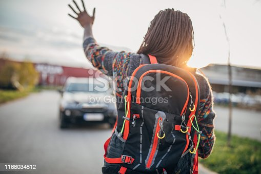 istock African-American woman with backpack 1168034812