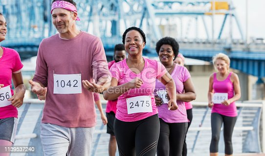 istock African-American woman with group in breast cancer rally 1139537240