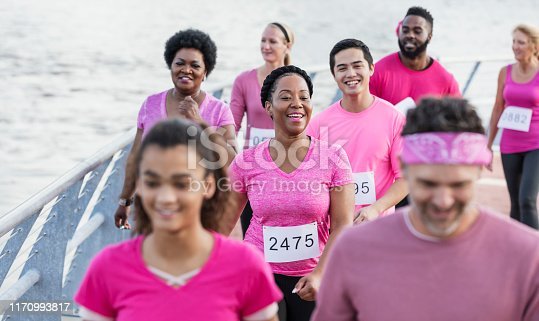 istock African-American woman with group in breast cancer rally 1170993817