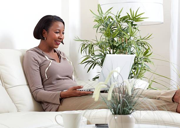 African-American woman with laptop. – Foto