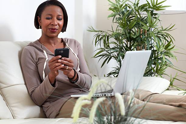 african-american woman with smartphone. - older woman phone stock photos and pictures