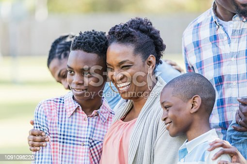 1091098220istockphoto African-American woman with two sons, laughing 1091098220