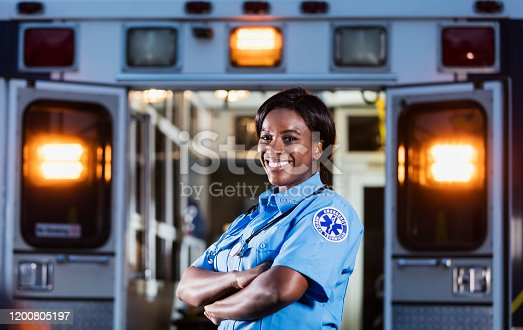 istock African-American woman working as paramedic 1200805197