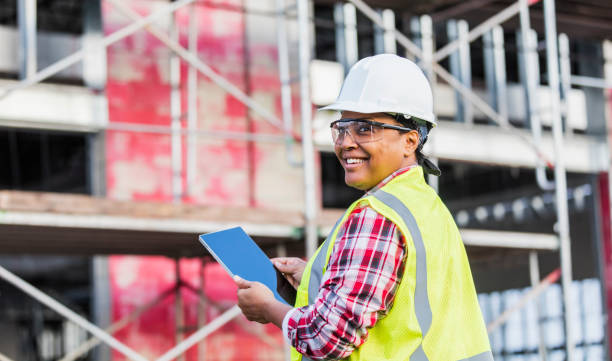 African-American woman working at construction site stock photo