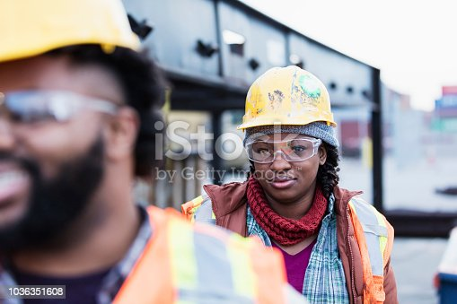 istock African-American woman working at shipping port 1036351608