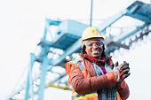 istock African-American woman working at shipping port 1036354066