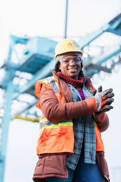 African-American woman working at shipping port stock photo