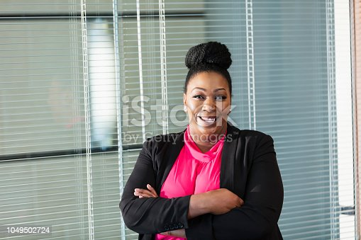 istock African-American woman working in office 1049502724