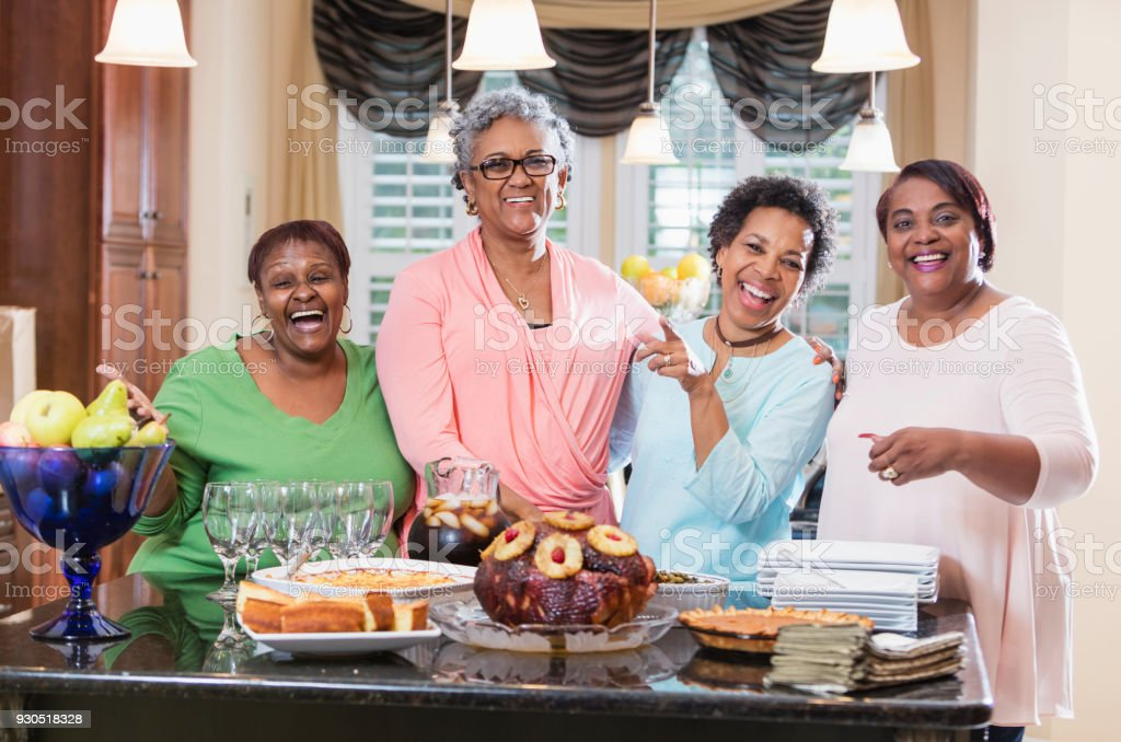 African-American women with home cooked meal stock photo