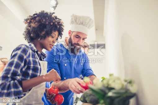 istock African-American young woman in cooking class choosing ingredients 923614090
