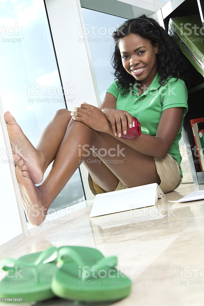 African-american young woman relaxing at home stock photo
