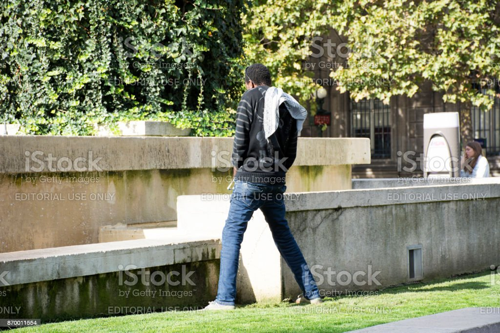African-French people peeing at outdoor stock photo