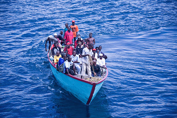 Africans in an overloaded boat stock photo