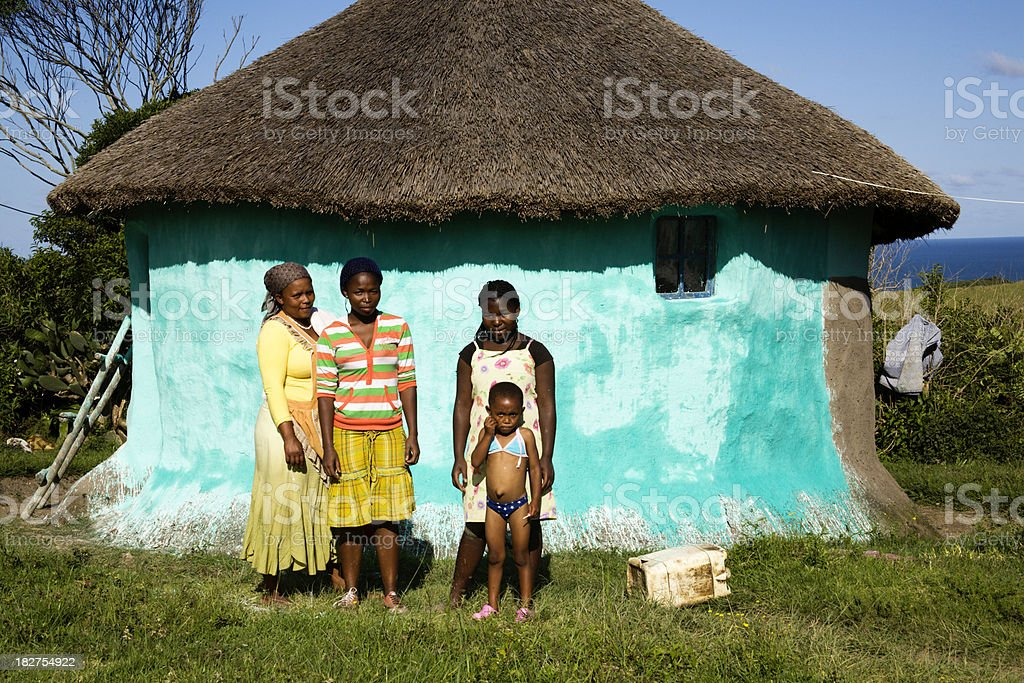 Africans outside their hut Transkei coast South Africa. stock photo