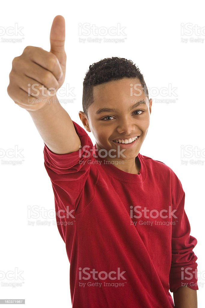 Africian ethnicity teenage boy gesturing thumbs up royalty-free stock photo