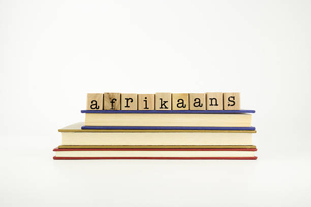 Afrikaans language word on wood stamps and books stock photo