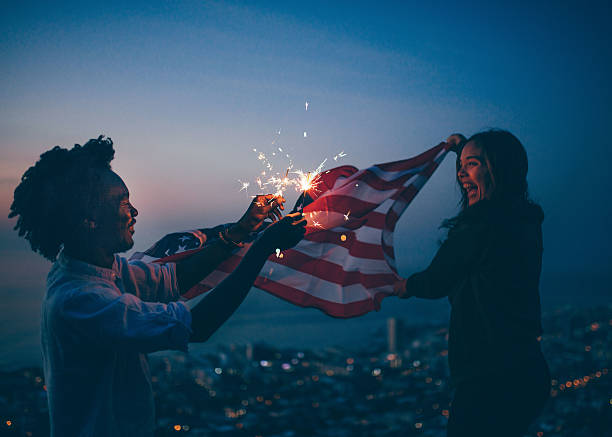 afro amercian man and woman celebrating with usa flag and - happy 4th of july stock pictures, royalty-free photos & images