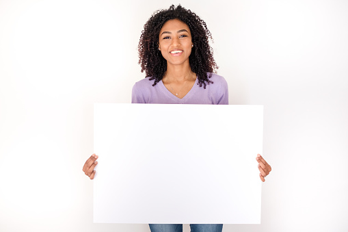 Portrait of black woman holding white banner isolated