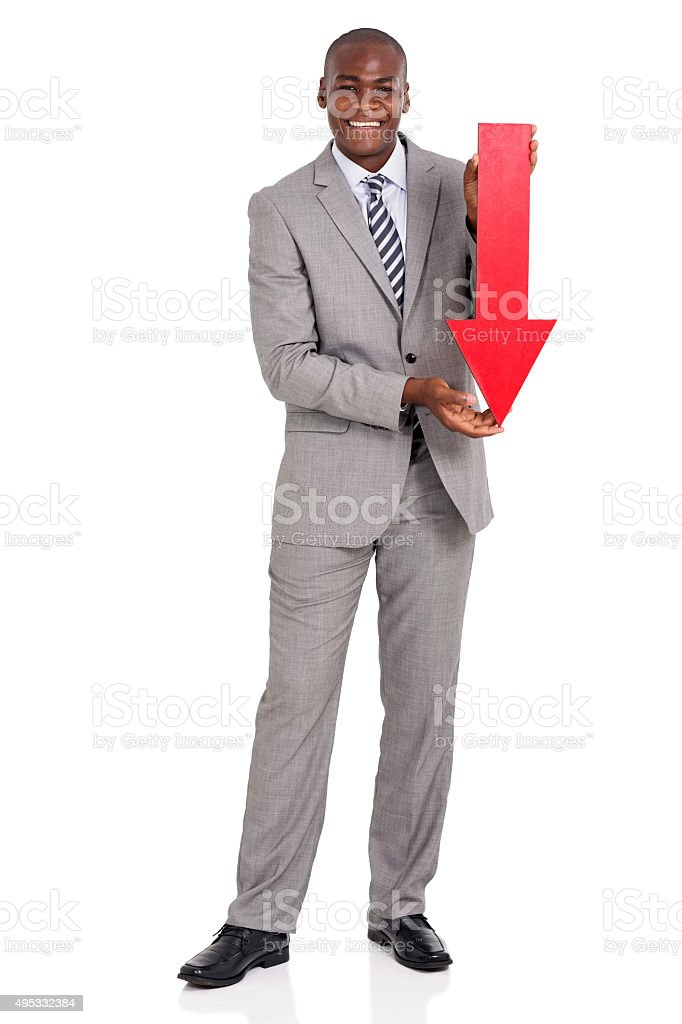 afro american businessman holding red arrow pointing down stock photo