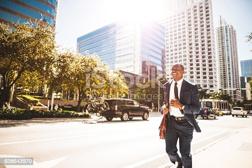 istock afro american businessman running in miami downtown 638643970