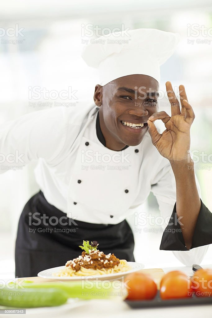 afro American chef delicious hand sign stock photo