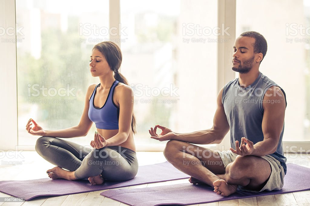 Afro American couple doing yoga stock photo
