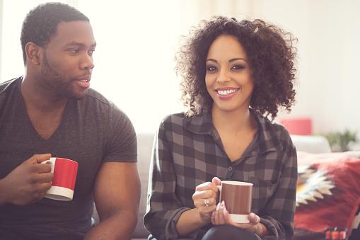 Afro American Couple Drinking Coffee At Home Stock Photo - Download Image Now