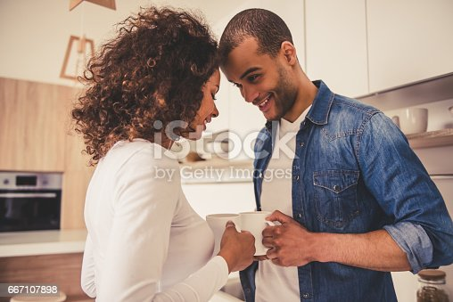 istock Afro American couple in kitchen 667107898