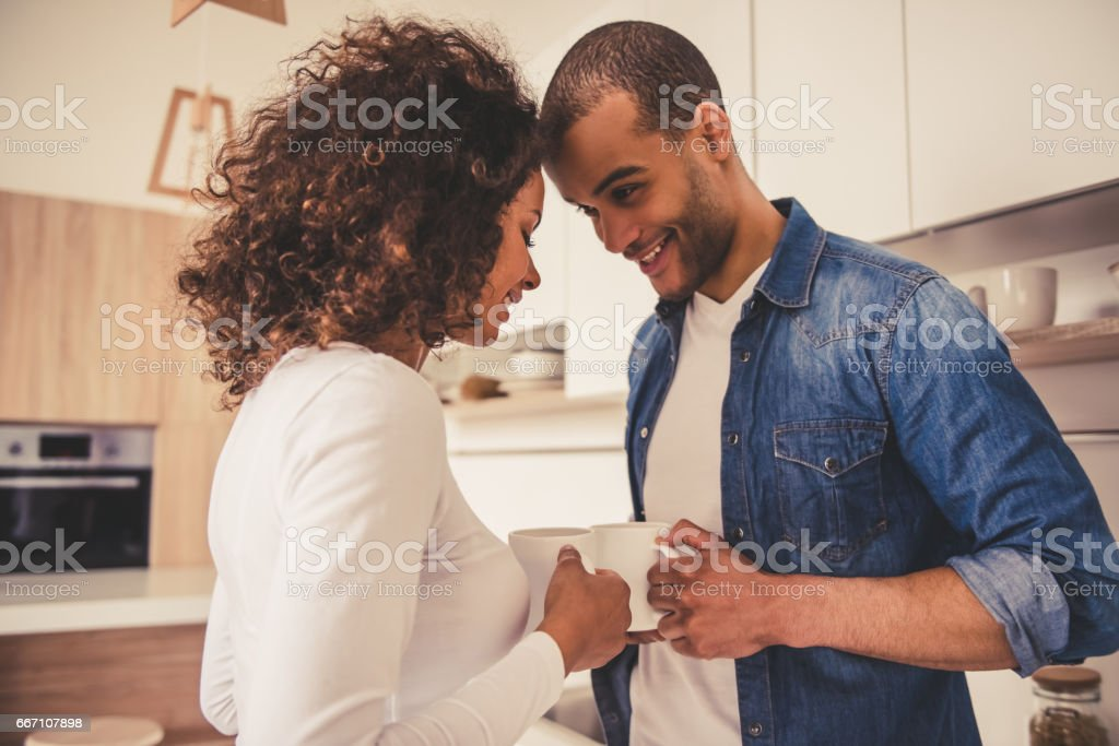 Afro American couple in kitchen stock photo