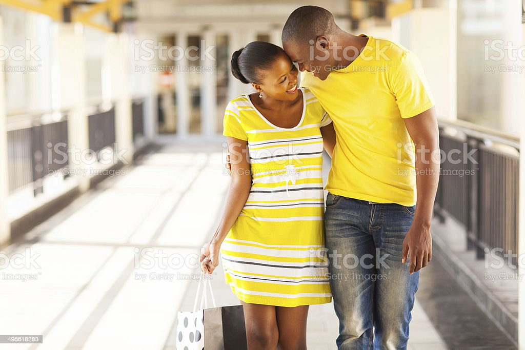 afro american couple in shopping mall stock photo